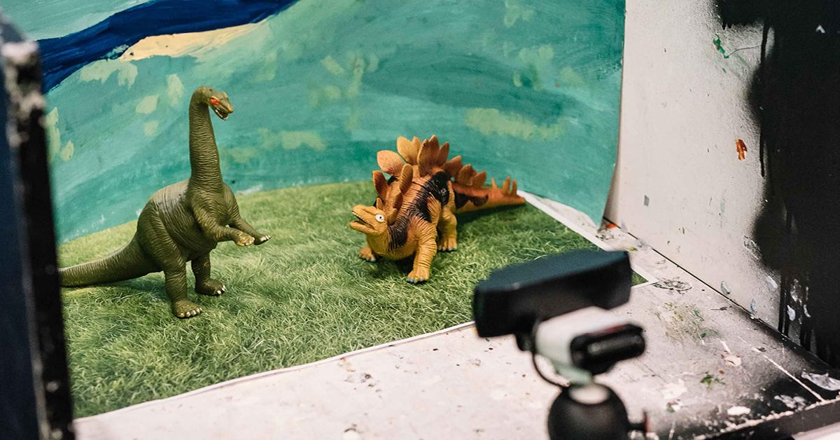animation diorama with dinosaur figurines