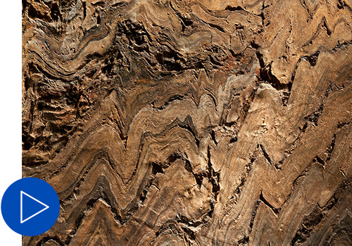 Closeup of a rock specimen shows a zig-zag formation pattern.