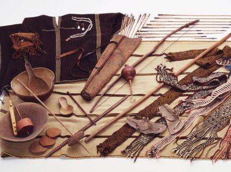 An array of Tarahumara objects, including bowls, bows, arrows, and weavings.