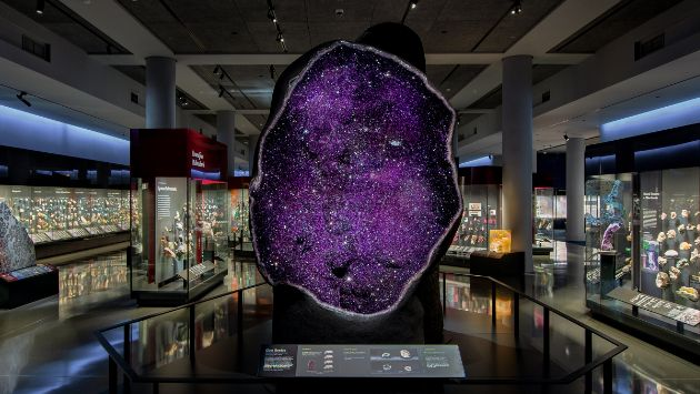 An overall view of the Mignone Halls of Gems and Minerals with a giant amethyst quartz.