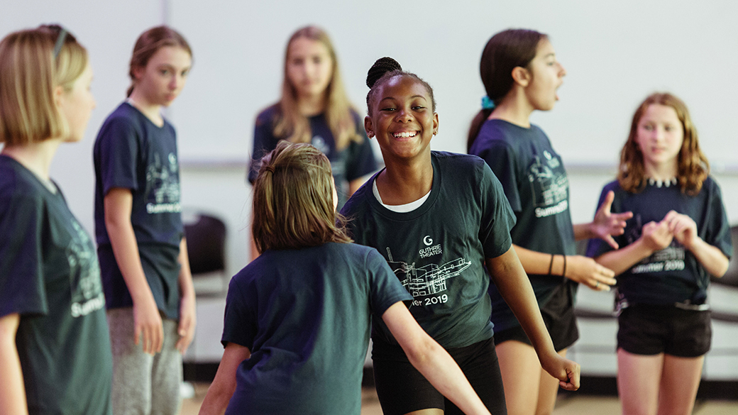 Young students participate in a summer camp exercise.