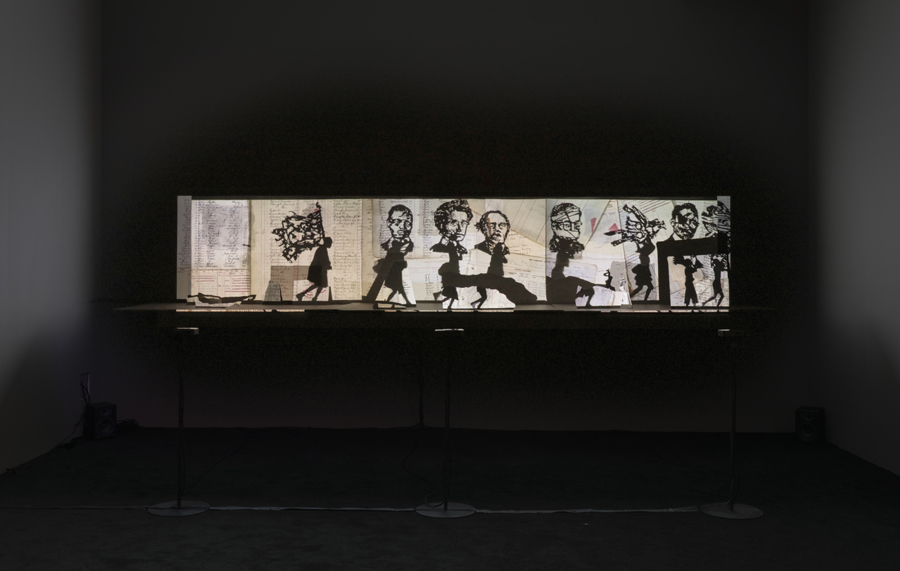 Projected silhouettes on a stage maquette.