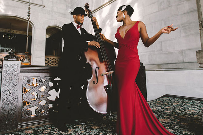 Acute Inflections duo with woman in red dress and man in tuxedo with cello