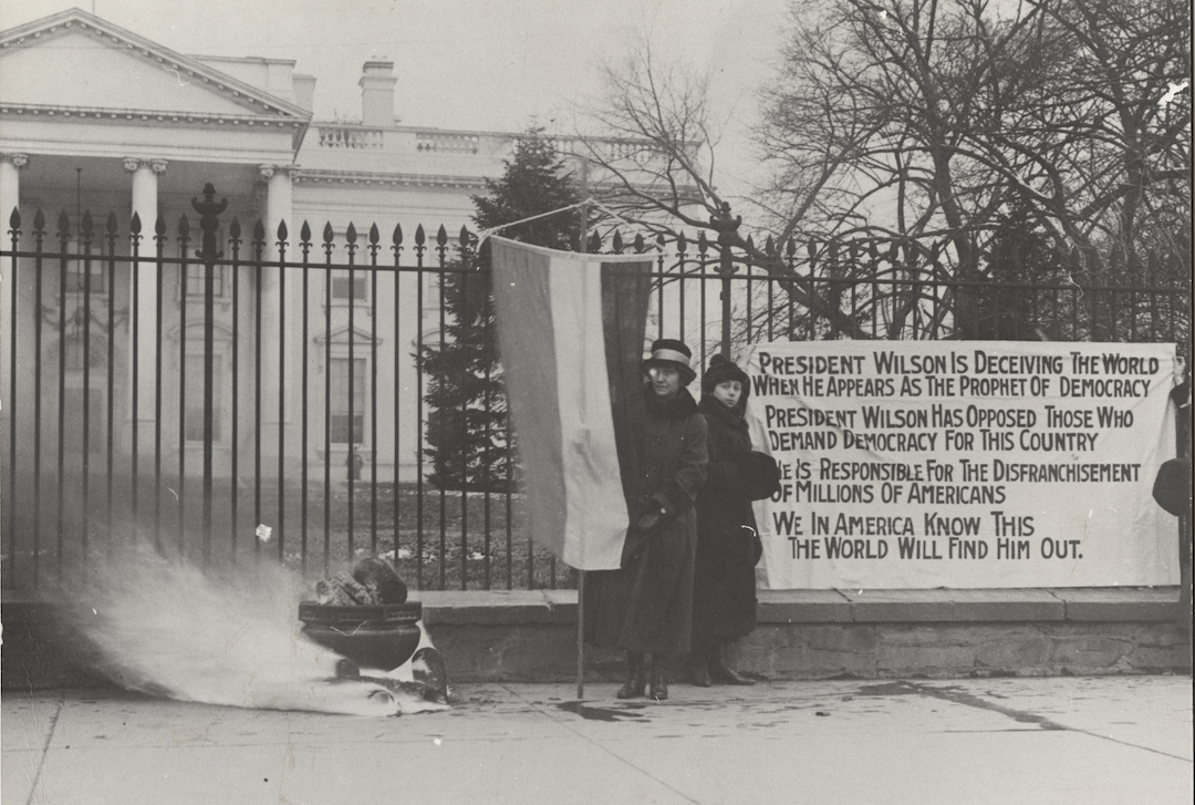 Suffragists bonfire and protest in front of the White House