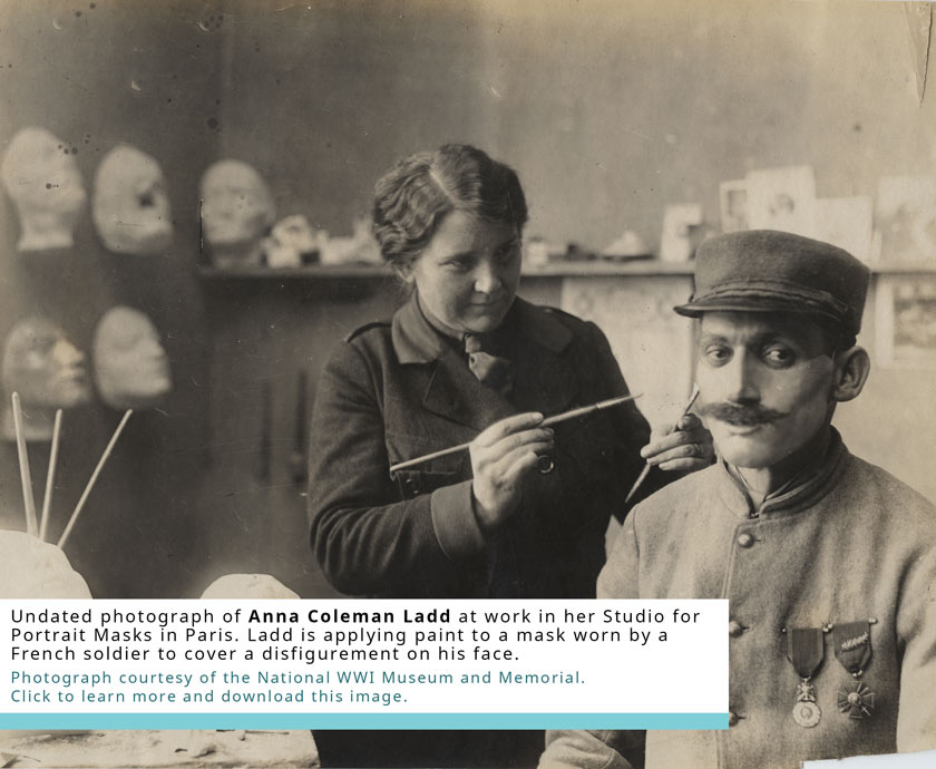 Undated Photograph of Anna Coleman Ladd at work in her Studio for Portrait Masks in Paris. Ladd is applying paint to a mast worn by a French soldier to cover a disfigurement on his face. Click to learn more.