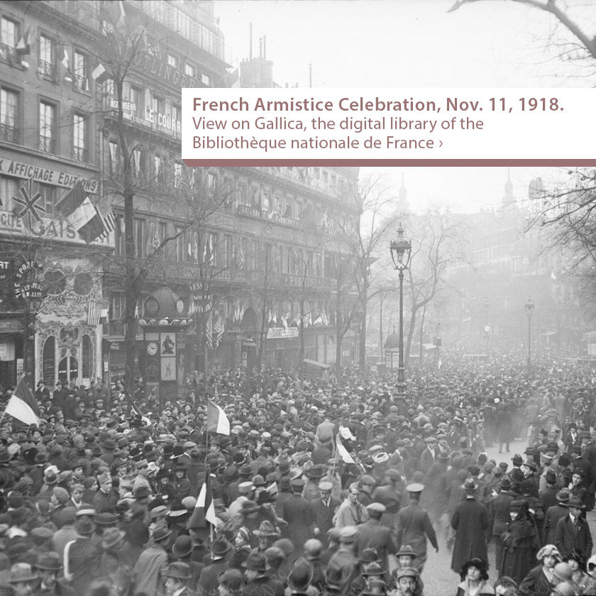 French Armistice Celebration - Scene of street packed with people holding flags.