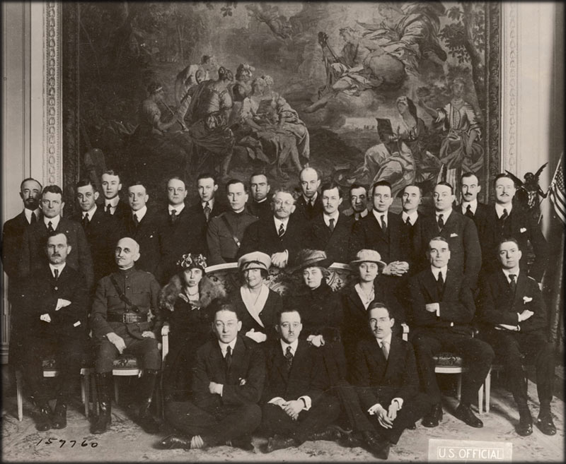 Journalists pose for a group photograph during the Paris Peace Conference in 1919.