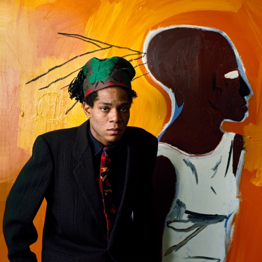 Jean-Michel Baasquiat posing in front of artwork