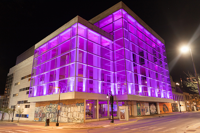 Overture Exterior, lit with purple lights