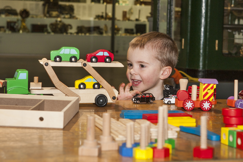 Young boy playing with toy cars at an Early Birds Event
