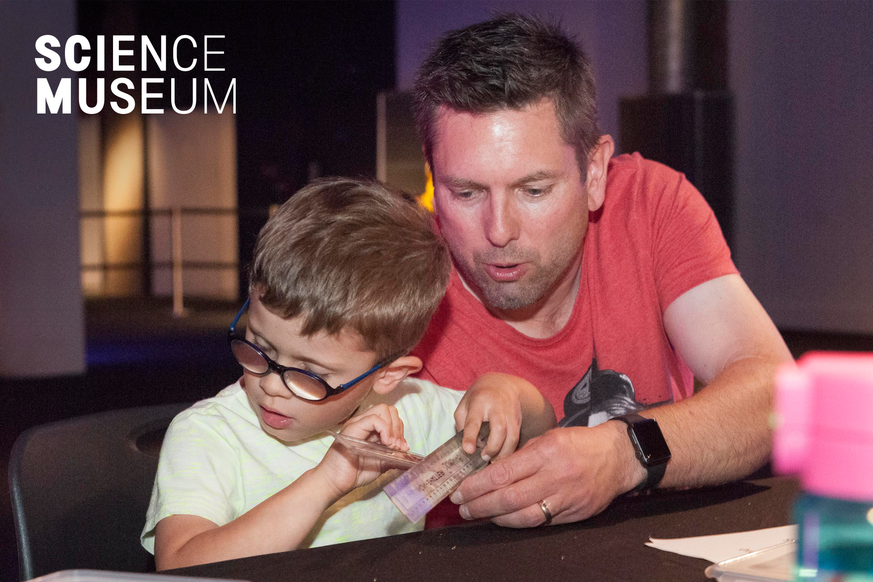 Image of a father and his son interacting at a Viscovery event