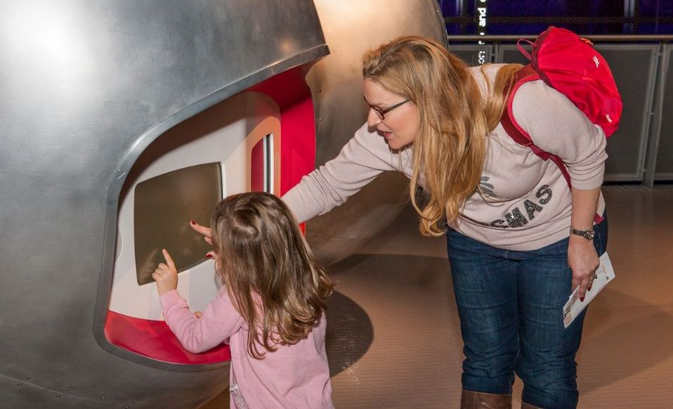 Mum and daughter looking at an interactive screen