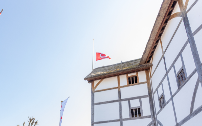 [IMAGE] A photograph of the Globe with its flag flying at half mast.