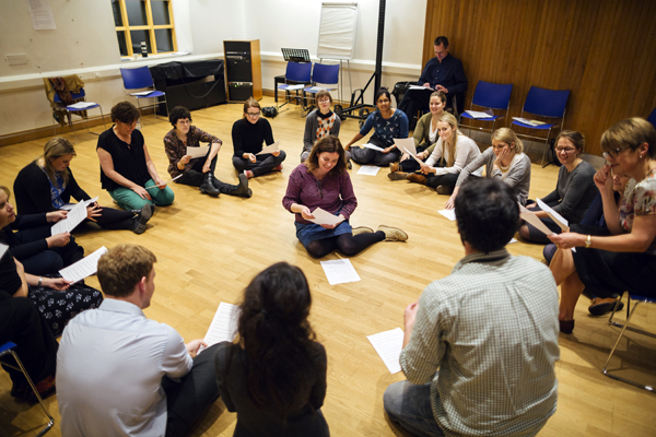 [IMAGE] Teacher sit in a circles as part of a CPD workshop.