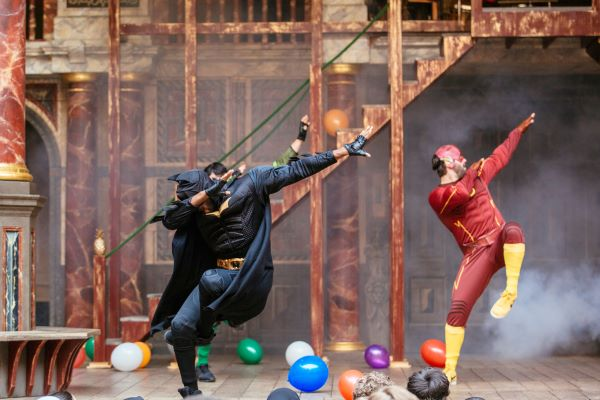 [IMAGE] Actors in a previous Playing Shakespeare with Deutsche Bank production dance whilst dressed as superheroes.