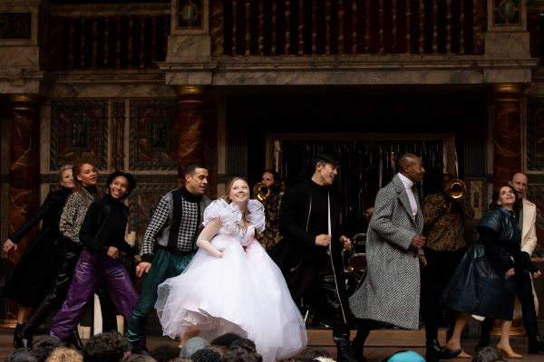 [IMAGE] Actors in a previous Playing Shakespeare with Deutsche Bank production dance the final jig with broad smiles.
