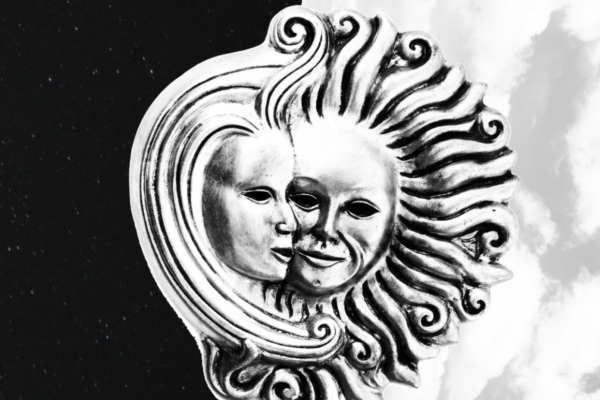 [IMAGE] A Venetian style silver sun and moon sit on a black and white background.
