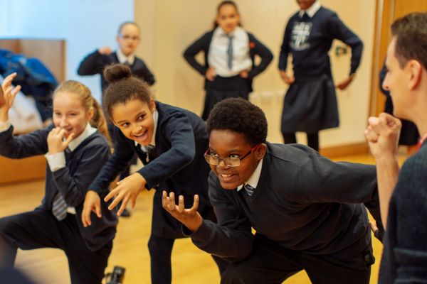 [IMAGE] School children taking part in a drama workshop.