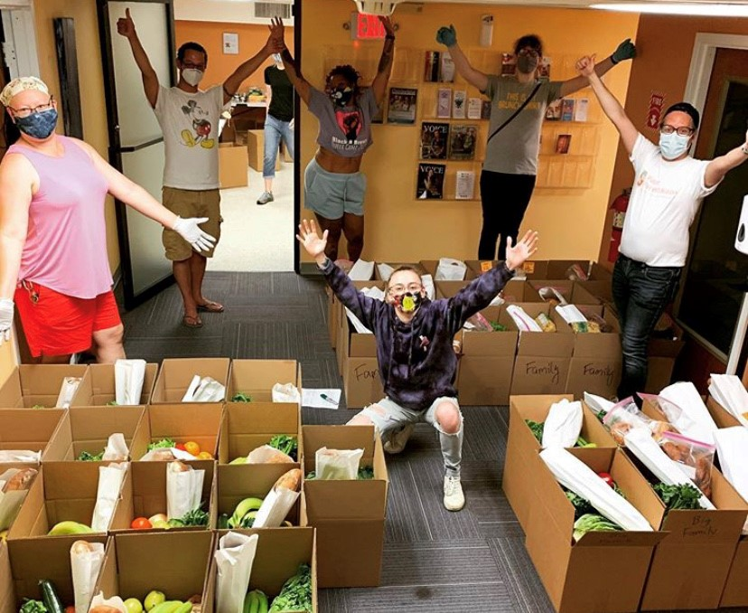 Volunteers at the New Haven Pride Center with Food Distribution boxes.